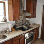 Kitchen Remodel with new sink custom cabinets and stove